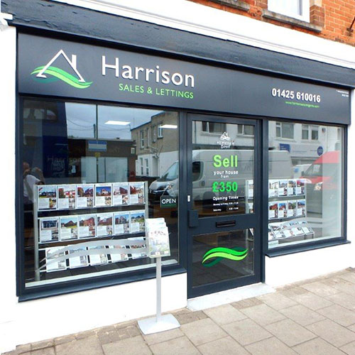 Harrison Estate Agent frontage showing combi ladder window displays